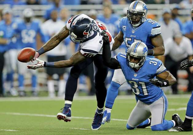Houston Texans wide receiver Andre Johnson (80) loses control of the ball after a hit by Detroit Lions cornerback Drayton Florence (31) during the first quarter of an NFL football game at Ford Field in Detroit, Thursday, Nov. 22, 2012. The pass fell incomplete. (AP Photo/Paul Sancya) Photo: Paul Sancya, Associated Press / AP