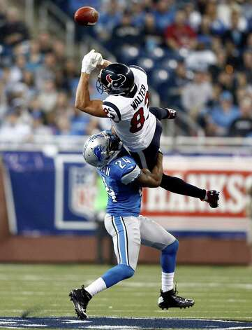 Detroit Lions strong safety Erik Coleman (24) breaks up a pass intended for Houston Texans wide receiver Kevin Walter (83) during the third quarter of an NFL football game at Ford Field in Detroit, Thursday, Nov. 22, 2012. (AP Photo/Rick Osentoski) Photo: Rick Osentoski, Associated Press / FR170444 AP