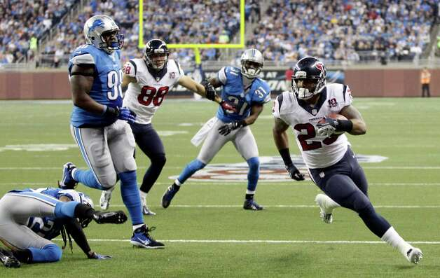 Houston Texans running back Arian Foster (23) runs into the end zone for a touchdown during the second quarter of an NFL football game against the Detroit Lions at Ford Field in Detroit, Thursday, Nov. 22, 2012. (AP Photo/Duane Burleson) Photo: Duane Burleson, Associated Press / FR38952 AP