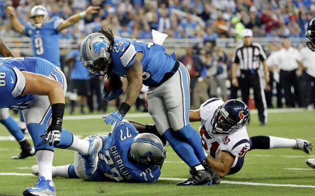 Detroit Lions running back Mikel Leshoure (25) scores a touchdown during the first quarter of an NFL football game against the Houston Texans at Ford Field in Detroit, Thursday, Nov. 22, 2012. (AP Photo/Paul Sancya) Photo: Paul Sancya, Associated Press / AP