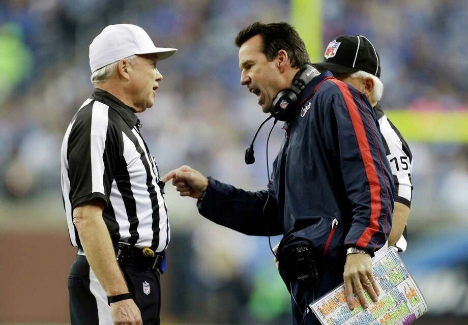 Houston Texans head coach Gary Kubiak, right, has a discussion with referee Walt Coleman during the second quarter of an NFL football game against the Detroit Lions at Ford Field in Detroit, Thursday, Nov. 22, 2012. (AP Photo/Paul Sancya) Photo: Paul Sancya, Associated Press / AP