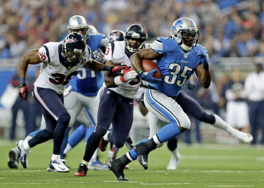 Detroit Lions running back Joique Bell (35) breaks away from the Houston Texans defense for a 23-yard touchdown run during the fourth quarter of an NFL football game at Ford Field in Detroit, Thursday, Nov. 22, 2012. (AP Photo/Paul Sancya) Photo: Paul Sancya, Associated Press / AP