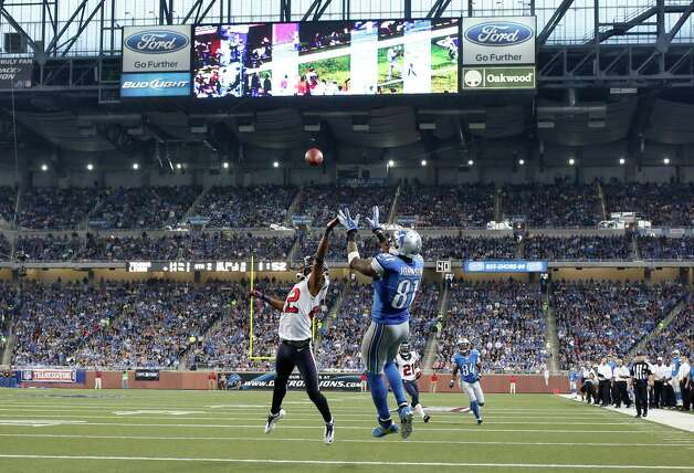 Detroit Lions wide receiver Calvin Johnson (81), defended by Houston Texans defensive back Alan Ball (22) catches a 22-yard pass in the end zone for a touchdown during the second quarter of an NFL football game at Ford Field in Detroit, Thursday, Nov. 22, 2012. (AP Photo/Rick Osentoski) Photo: Rick Osentoski, Associated Press / FR170444 AP