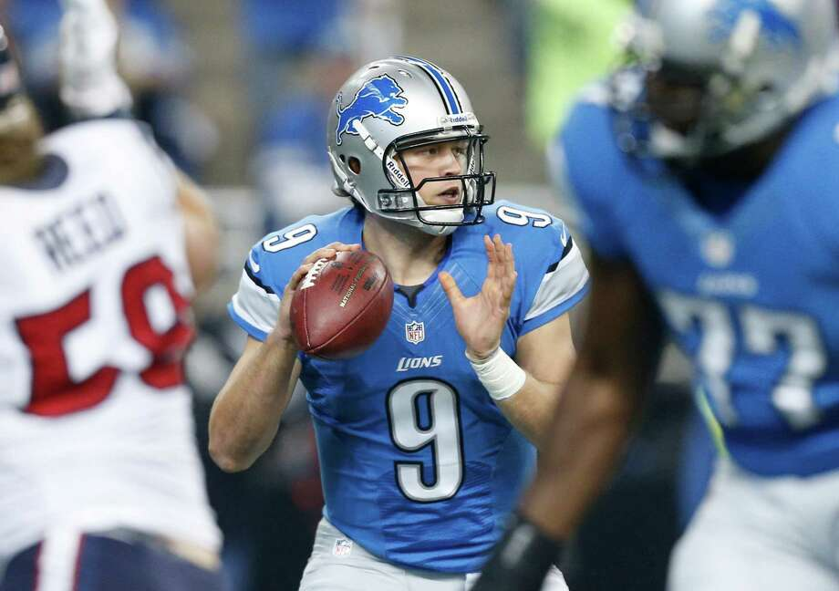 Detroit Lions quarterback Matthew Stafford (9) looks downfield during the first quarter of an NFL football game against the Houston Texans at Ford Field in Detroit, Thursday, Nov. 22, 2012. (AP Photo/Rick Osentoski) Photo: Rick Osentoski, Associated Press / FR170444 AP