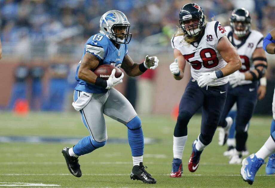 Detroit Lions receiver Mike Thomas is chased by Houston Texans outside linebacker Brooks Reed (58) during the first quarter of an NFL football game at Ford Field in Detroit, Thursday, Nov. 22, 2012. (AP Photo/Rick Osentoski) Photo: Rick Osentoski, Associated Press / FR170444 AP