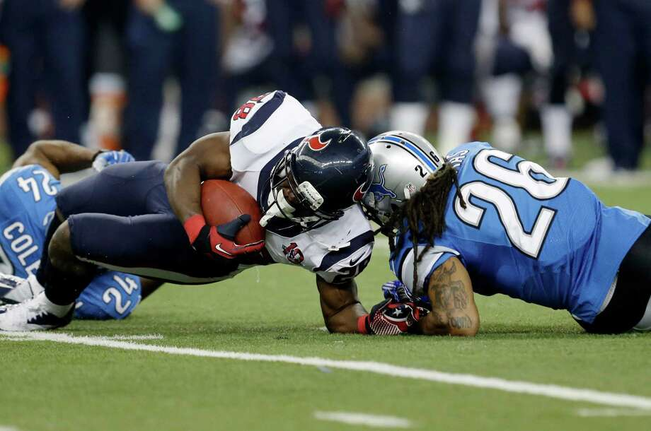 Houston Texans running back Justin Forsett (28) is hit by Detroit Lions free safety Louis Delmas (26) during the third quarter of an NFL football game at Ford Field in Detroit, Thursday, Nov. 22, 2012. (AP Photo/Paul Sancya) Photo: Paul Sancya, Associated Press / AP