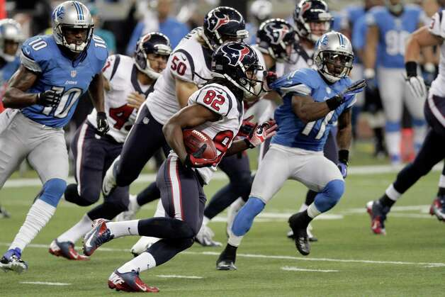 Houston Texans wide receiver Keshawn Martin (82) is chased by Detroit Lions' Kassim Osgood (10) and Stefan Logan (11) returns a kick during the first quarter of an NFL football game at Ford Field in Detroit, Thursday, Nov. 22, 2012. (AP Photo/Duane Burleson) Photo: Duane Burleson, Associated Press / FR38952 AP