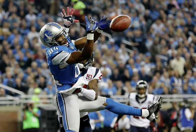 Houston Texans defensive back Brice McCain, back, knocks a pass out of the hands of Detroit Lions wide receiver Ryan Broyles (84) during the first quarter of an NFL football game at Ford Field in Detroit, Thursday, Nov. 22, 2012. (AP Photo/Paul Sancya) Photo: Paul Sancya, Associated Press / AP