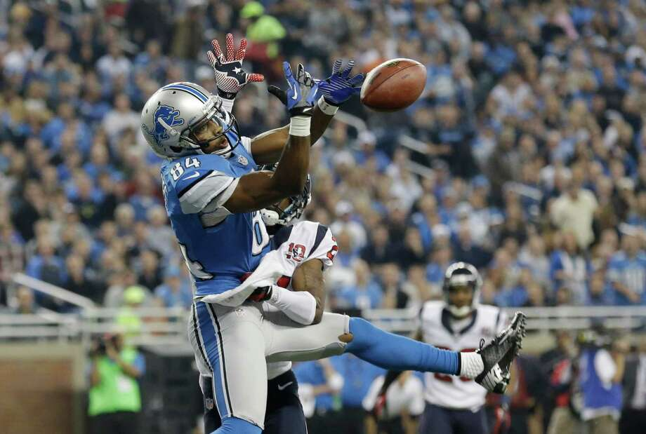 Detroit Lions wide receiver Ryan Broyles (84) has the back knocked out of his hands by Houston Texans defensive back Brice McCain during the first quarter of an NFL football game at Ford Field in Detroit, Thursday, Nov. 22, 2012. (AP Photo/Paul Sancya) Photo: Paul Sancya, Associated Press / AP
