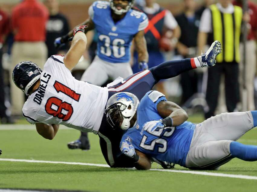 Houston Texans tight end Owen Daniels (81) falls into the end zone over Detroit Lions middle linebacker Stephen Tulloch (55) to score a touchdown during the second quarter of an NFL football game at Ford Field in Detroit, Thursday, Nov. 22, 2012. (AP Photo/Paul Sancya)