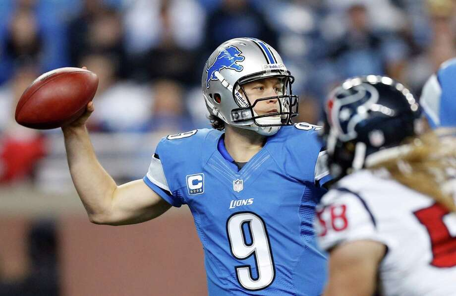 Detroit Lions quarterback Matthew Stafford (9) reaches back to pass during the first quarter of an NFL football game against the Houston Texans at Ford Field in Detroit, Thursday, Nov. 22, 2012. (AP Photo/Rick Osentoski) Photo: Rick Osentoski, Associated Press / FR170444 AP