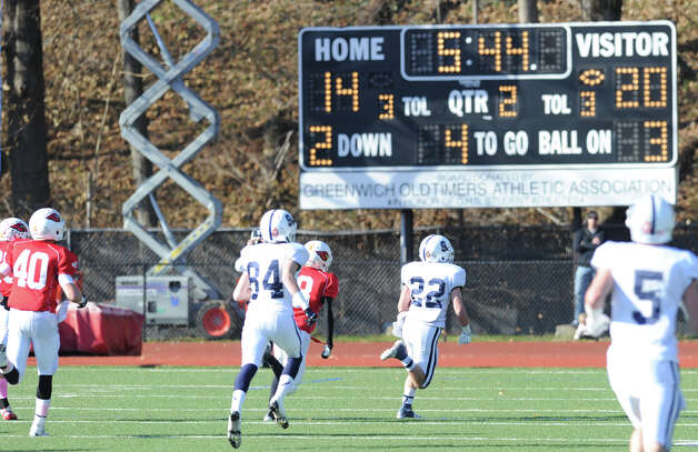Staples Running back Joey Zelkowitz #22 scores a touchdown on a run during theFCIAC championship football game between Staples High School and Greenwich High School at Greenwich, Thursday afternoon, Nov. 22, 2012. Zelkowitz rushed for 312 yards and was named MVP as Staples defeated Greenwich 48-30 to win the championship. Photo: Bob Luckey / Greenwich Time