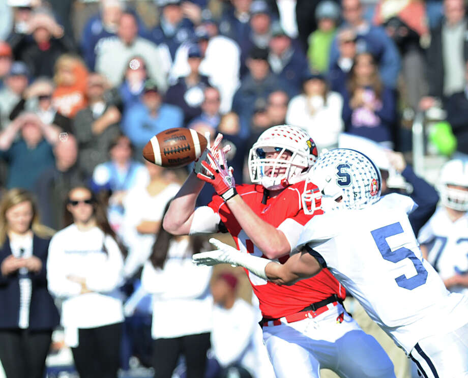 At left, Receiver Joe Kelly of Greenwich goes for a catch that was broken-up by Nick Kelly # 5 of Staples during the FCIAC championship football game between Staples High School and Greenwich High School at Greenwich, Thursday afternoon, Nov. 22, 2012. Staples defeated Greenwich 48-30 to win the championship. Photo: Bob Luckey / Greenwich Time