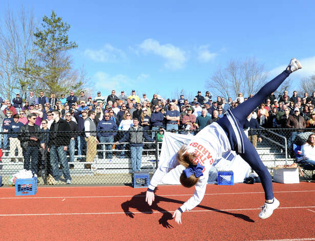A Staples cheerleader in action during the FCIAC championship football game between Staples High School and Greenwich High School at Greenwich, Thursday afternoon, Nov. 22, 2012. Staples defeated Greenwich 48-30 to win the championship. Photo: Bob Luckey / Greenwich Time