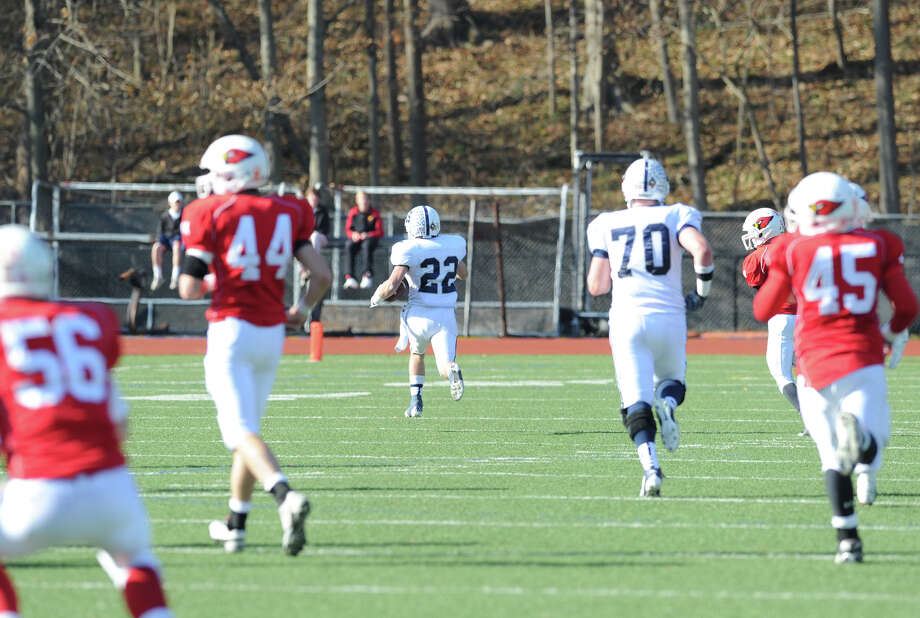 At center, Joey Zelkowitz # 22 of Staples on a long run during the second quarter in the FCIAC championship football game between Staples High School and Greenwich High School at Greenwich, Thursday afternoon, Nov. 22, 2012. Zelkowitz was named MVP and ran for 312 yards as Staples defeated Greenwich 48-30 to win the championship. Photo: Bob Luckey / Greenwich Time