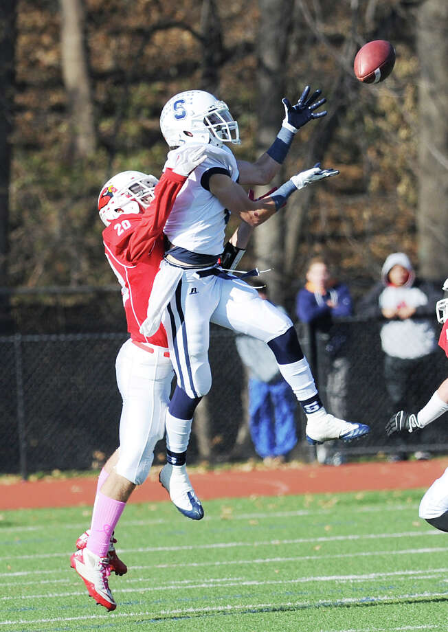 At left, Shawn Dunster # 20 of Greenwich breaks up a pass play to a Staples receiver during the FCIAC championship football game between Staples High School and Greenwich High School at Greenwich, Thursday afternoon, Nov. 22, 2012. Staples defeated Greenwich 48-30 to win the championship. Photo: Bob Luckey / Greenwich Time