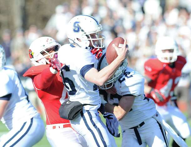 Quarterback Jack Massie # 16 of Staples gets sacked during the FCIAC championship football game between Staples High School and Greenwich High School at Greenwich, Thursday afternoon, Nov. 22, 2012. Staples defeated Greenwich 48-30 to win the championship. Photo: Bob Luckey / Greenwich Time