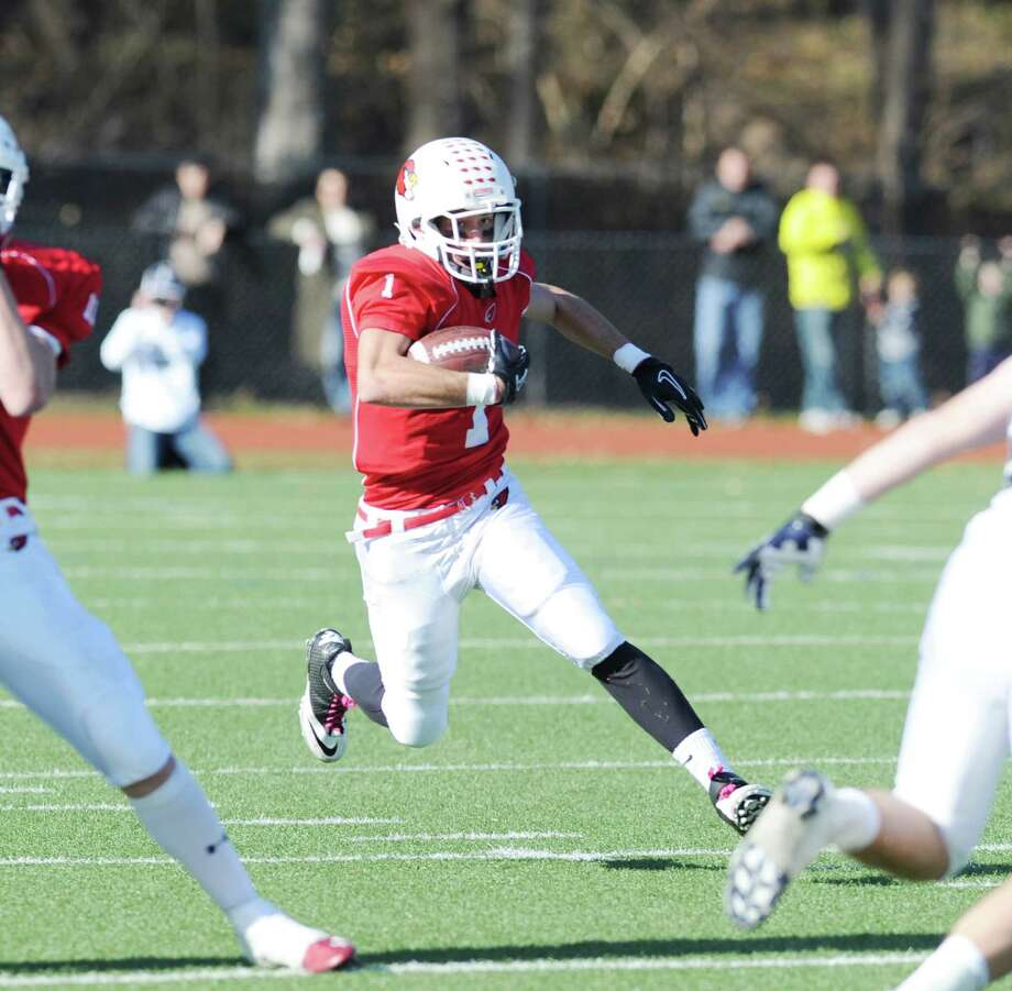 Vincent Ferraro # 1 of Greenwich returns a kick during the FCIAC championship football game between Staples High School and Greenwich High School at Greenwich, Thursday afternoon, Nov. 22, 2012. Staples defeated Greenwich 48-30 to win the championship. Photo: Bob Luckey / Greenwich Time