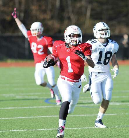 Vincent Ferraro # 1 of Greenwich breaks a long run during a kick return in the FCIAC championship football game between Staples High School and Greenwich High School at Greenwich, Thursday afternoon, Nov. 22, 2012. Staples defeated Greenwich 48-30 to win the championship. Photo: Bob Luckey / Greenwich Time