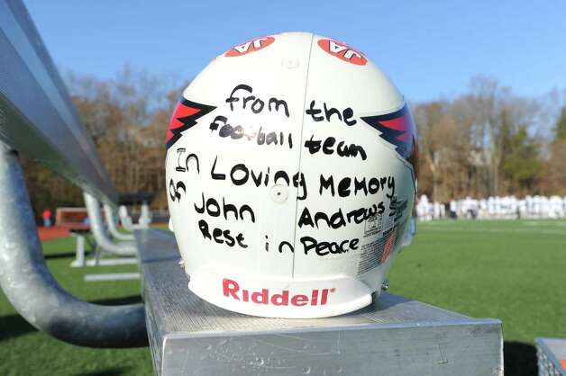 The inscribed helmet the Greenwich football team dedicated to fan and supporter, John Andrews of Greenwich, who past away recently, displayed on a bench prior to the FCIAC championship football game between Staples High School and Greenwich High School at Greenwich, Thursday afternoon, Nov. 22, 2012. Staples defeated Greenwich 48-30 to win the championship. Photo: Bob Luckey / Greenwich Time
