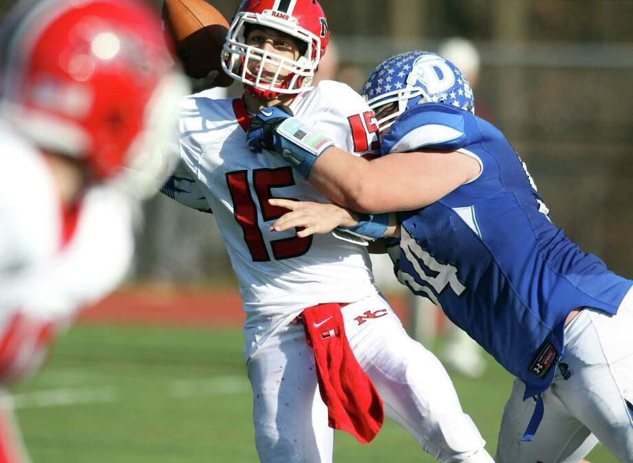 New Canaan QB Nick Cascione attempts a swing pass to a New Canaan running back as Darien defender Matty D'Andrea closes in. The Blue Wave dominated play, winning the annual Turkey Day event, 36-21 in Darien. Photo: J. Gregory Raymond / Stamford Advocate Freelance;  © J. Gregory Raymond