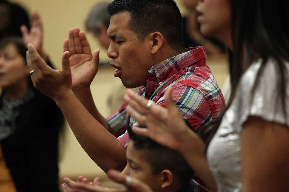 Jesus Gonzalez worships in song during a service at Calvary Church. With a growing congregation, that institution expects to break ground on new property next year. Photo: Lisa Krantz, San Antonio Express-News / © 2012 San Antonio Express-News