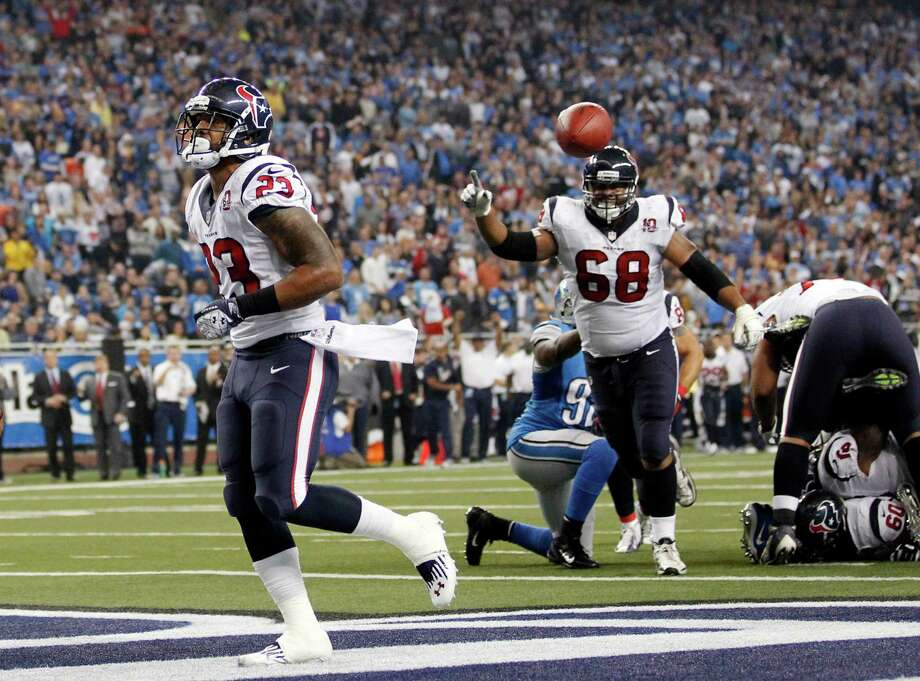 Houston Texans running back Arian Foster, left, and teammate tackle Ryan Harris (68) celebrate after Foster's touchdown during the fourth quarter of an NFL football game against the Detroit Lions at Ford Field in Detroit, Thursday, Nov. 22, 2012. (AP Photo/Rick Osentoski) Photo: Rick Osentoski, Associated Press / FR170444 AP