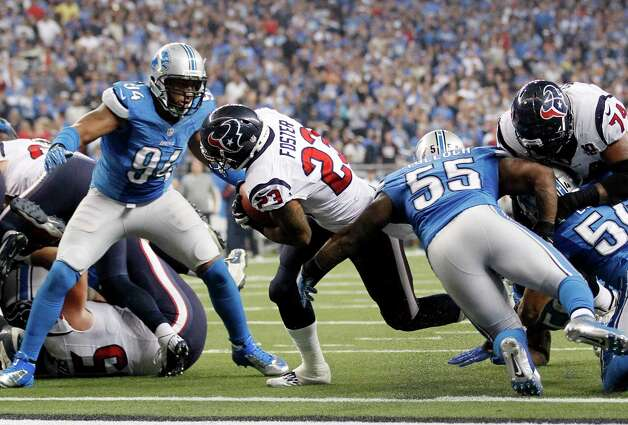 Houston Texans running back Arian Foster breaks away from Detroit Lions defensive end Lawrence Jackson (94) and linebacker Stephen Tulloch (55) for a touchdown during the fourth quarter of an NFL football game at Ford Field in Detroit, Thursday, Nov. 22, 2012. (AP Photo/Rick Osentoski) Photo: Rick Osentoski, Associated Press / FR170444 AP