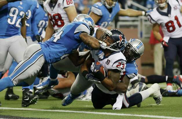 Houston Texans running back Arian Foster (23) is stopped at the goal line by Detroit Lions strong safety Erik Coleman (24) and linebacker Stephen Tulloch (55) during the fourth quarter of an NFL football game at Ford Field in Detroit, Thursday, Nov. 22, 2012. Foster scored on the next play. (AP Photo/Paul Sancya) Photo: Paul Sancya, Associated Press / AP