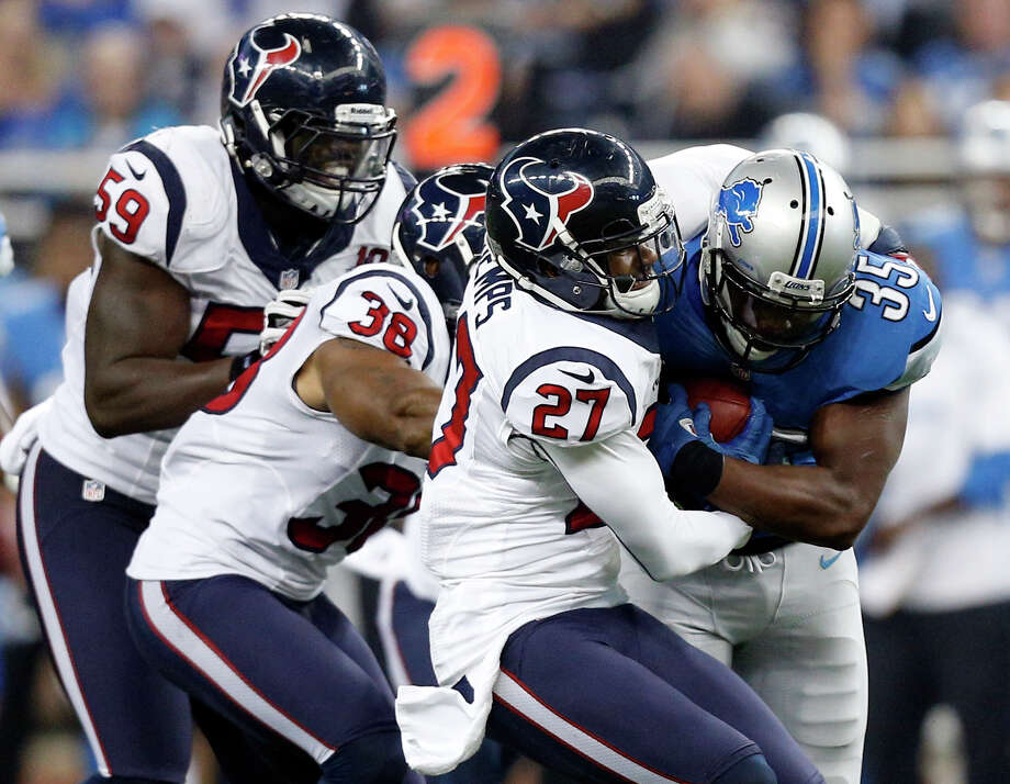 Houston Texans linebacker Whitney Mercilus (59), free safety Danieal Manning (38), and defensive back Quintin Demps (27) gang up on Detroit Lions running back Joique Bell (35) during the fourth quarter of an NFL football game at Ford Field in Detroit, Thursday, Nov. 22, 2012. (AP Photo/Rick Osentoski) Photo: Rick Osentoski, Associated Press / FR170444 AP