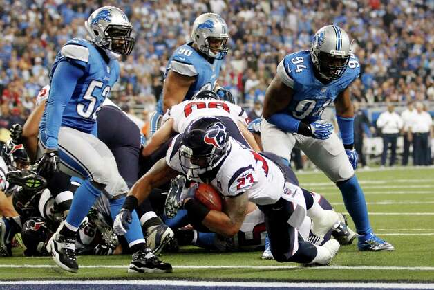 Houston Texans running back Arian Foster falls into the end zone for a touchdown during the fourth quarter of an NFL football game against the Detroit Lions at Ford Field in Detroit, Thursday, Nov. 22, 2012. (AP Photo/Rick Osentoski) Photo: Rick Osentoski, Associated Press / FR170444 AP