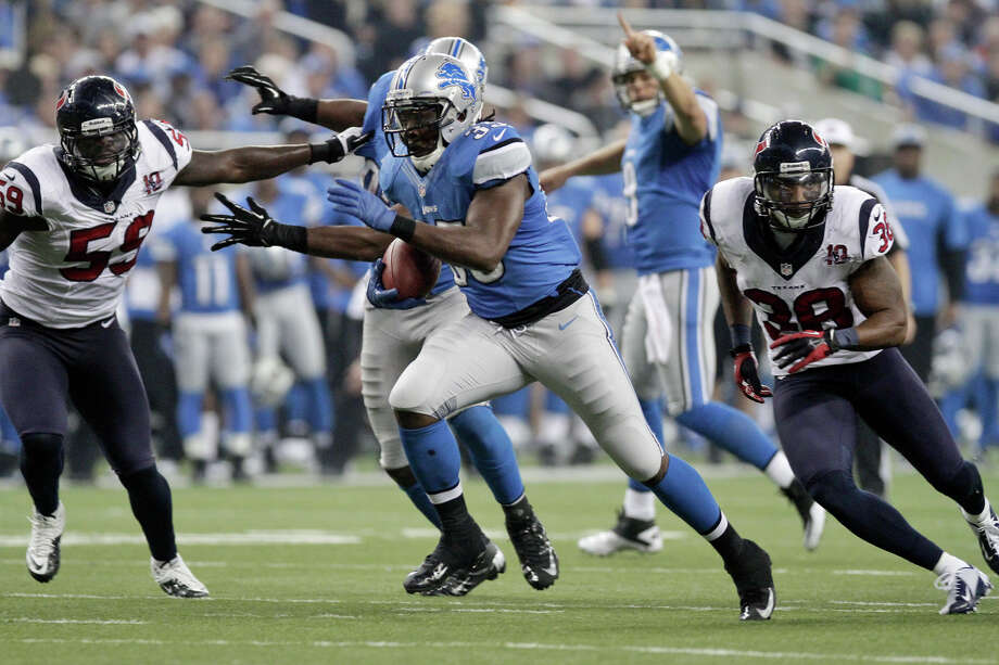 Detroit Lions running back Joique Bell (35) breaks away from the Houston Texans linebacker Whitney Mercilus (59) and free safety Danieal Manning (38) for a 23-yard touchdown run during the fourth quarter of an NFL football game at Ford Field in Detroit, Thursday, Nov. 22, 2012. (AP Photo/Duane Burleson) Photo: Duane Burleson, Associated Press / FR38952 AP