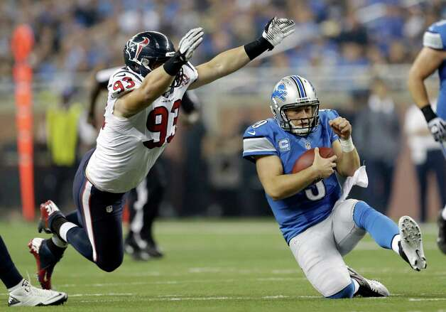 Detroit Lions quarterback Matthew Stafford (9) slides after scrambling away from Houston Texans defensive end Jared Crick (93) during the fourth quarter of an NFL football game at Ford Field in Detroit, Thursday, Nov. 22, 2012. (AP Photo/Paul Sancya) Photo: Paul Sancya, Associated Press / AP
