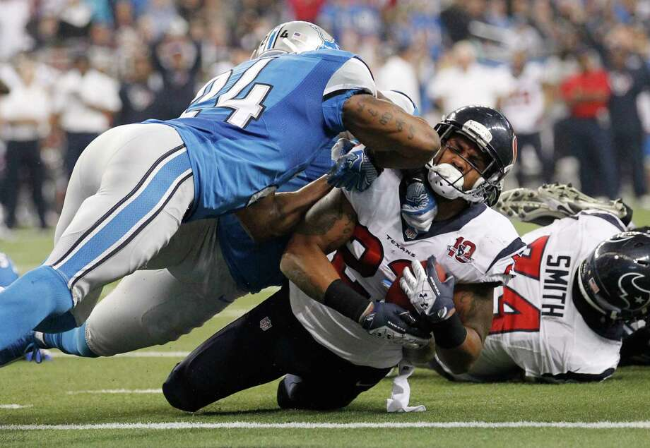Houston Texans running back Arian Foster (23) is stopped at the goal line by Detroit Lions strong safety Erik Coleman (24) during the fourth quarter of an NFL football game at Ford Field in Detroit, Thursday, Nov. 22, 2012. Foster scored on the next play. (AP Photo/Rick Osentoski) Photo: Rick Osentoski, Associated Press / FR170444 AP