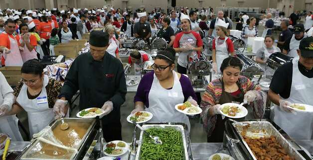 Thousands of seniors and people in need are served at the Raul Jimenez Thanksgiving Dinner at the Henry B. Gonzalez Convention Center, Thursday, Nov. 22, 2012. Photo: Bob Owen, San Antonio Express-News / © 2012 San Antonio Express-News