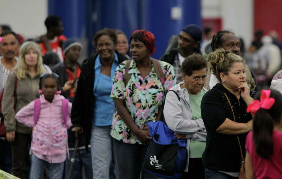 Crowds wait in line during the Big Super Feast at the George R. Brown Convention Center Thursday, Nov. 22, 2012, in Houston. Photo: Melissa Phillip, Houston Chronicle / © 2012 Houston Chronicle