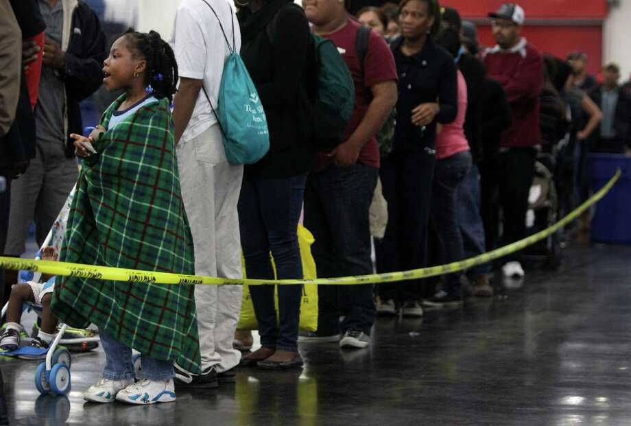 Aiyana Burks, 5, waits in line during the Big Super Feast at the George R. Brown Convention Center Thursday, Nov. 22, 2012, in Houston. Photo: Melissa Phillip, Houston Chronicle / © 2012 Houston Chronicle