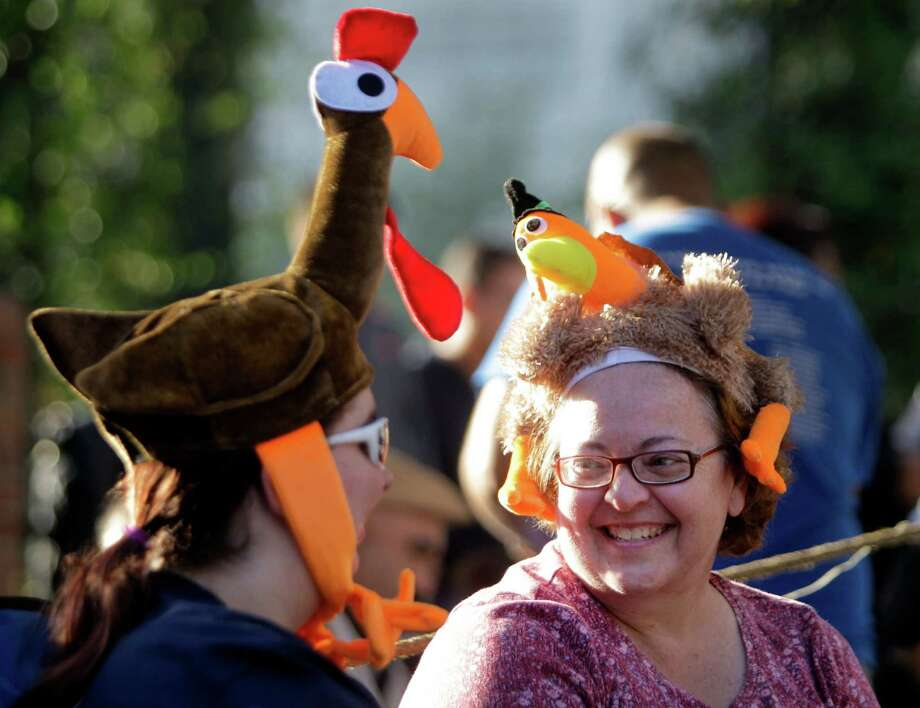 Lindsay Alexander, left, and her mother-in-law, Doris Alexander enjoy the 63rd Annual Houston Holiday Parade in downtown Thursday, Nov. 22, 2012, in Houston. Photo: Melissa Phillip, Houston Chronicle / © 2012 Houston Chronicle
