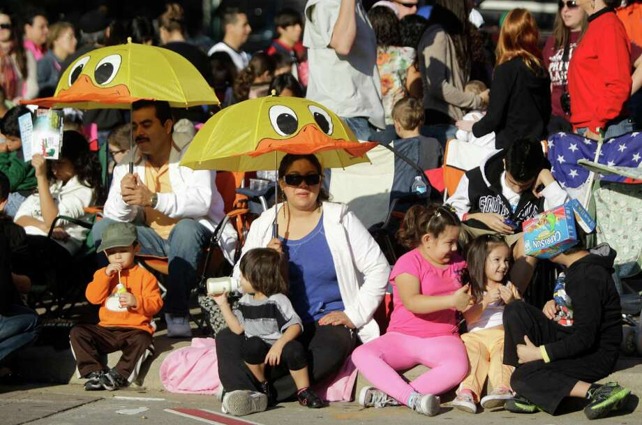 Crowds line the streets during the 63rd Annual Houston Holiday Parade in downtown Thursday, Nov. 22, 2012, in Houston. Photo: Melissa Phillip, Houston Chronicle / © 2012 Houston Chronicle