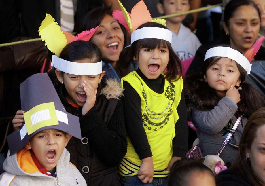 Angel Vasquez, 5, left, with his sisters, Jenny Vasquez, 9, and Ashley Vasquez, 4, and their cousin, Hannah Salas, 2, enjoy the 63rd Annual Houston Holiday Parade in downtown Thursday, Nov. 22, 2012, in Houston. Photo: Melissa Phillip, Houston Chronicle / © 2012 Houston Chronicle