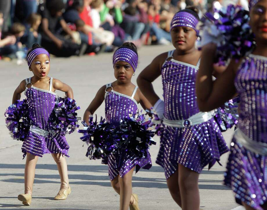 Designed 2 Dance members perform during the 63rd Annual Houston Holiday Parade in downtown Thursday, Nov. 22, 2012, in Houston. Photo: Melissa Phillip, Houston Chronicle / © 2012 Houston Chronicle