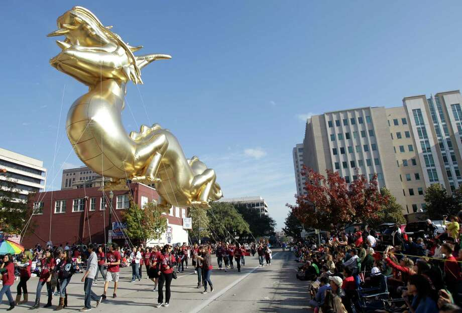 A Dragon balloon is carried during the 63rd Annual Houston Holiday Parade in downtown Thursday, Nov. 22, 2012, in Houston. Photo: Melissa Phillip, Houston Chronicle / © 2012 Houston Chronicle