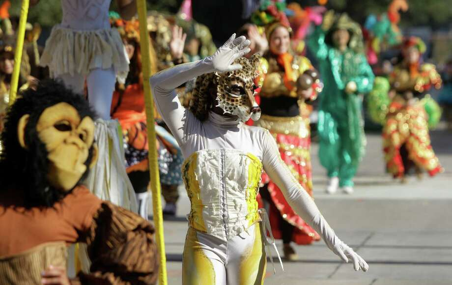 Houston Ballet characters move along the parade route during the 63rd Annual Houston Holiday Parade in downtown Thursday, Nov. 22, 2012, in Houston. Photo: Melissa Phillip, Houston Chronicle / © 2012 Houston Chronicle