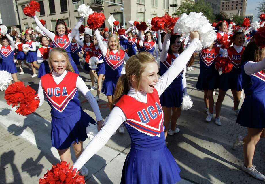 Cheerleaders perform during the 63rd Annual Houston Holiday Parade in downtown Thursday, Nov. 22, 2012, in Houston. Photo: Melissa Phillip, Houston Chronicle / © 2012 Houston Chronicle