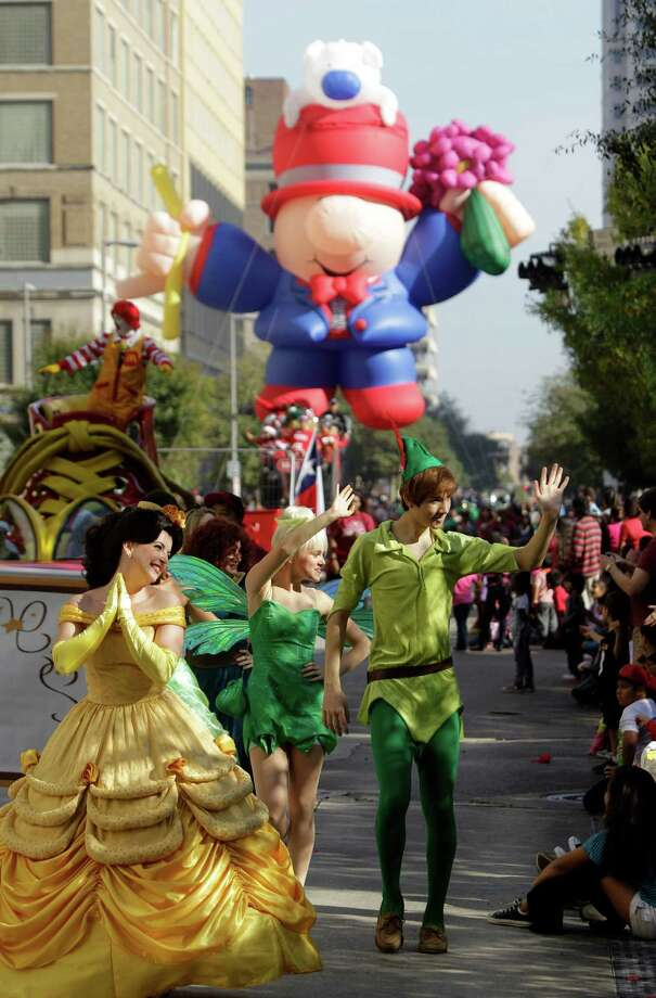 Story book characters and a balloon float move along the parade route during the 63rd Annual Houston Holiday Parade in downtown Thursday, Nov. 22, 2012, in Houston. Photo: Melissa Phillip, Houston Chronicle / © 2012 Houston Chronicle