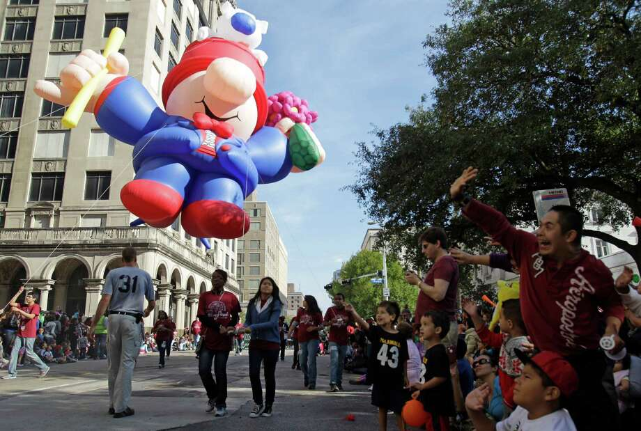 A balloon float moves along the parade route during the 63rd Annual Houston Holiday Parade in downtown Thursday, Nov. 22, 2012, in Houston. Photo: Melissa Phillip, Houston Chronicle / © 2012 Houston Chronicle