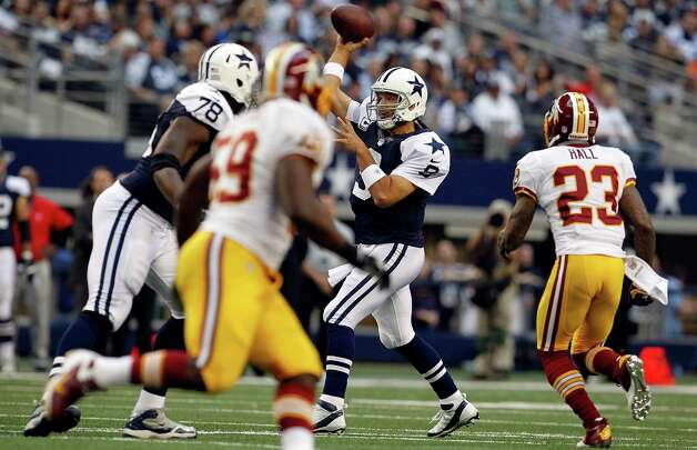 Tony Romo #9 of the Dallas Cowboys looks for an open receiver under pressure from the Washington Redskins on Thanksgiving Day at Cowboys Stadium on November 22, 2012 in Arlington, Texas. Photo: Tom Pennington, Getty Images / 2012 Getty Images