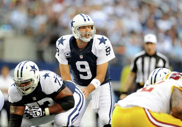 Dallas Cowboys quarterback Tony Romo (9) at the line of scrimmage against the Washington Redskins during an NFL football game Thursday, Nov. 22, 2012, in Arlington, Texas. (AP Photo/Matt Strasen) Photo: Matt Strasen, Associated Press / FR170476 AP