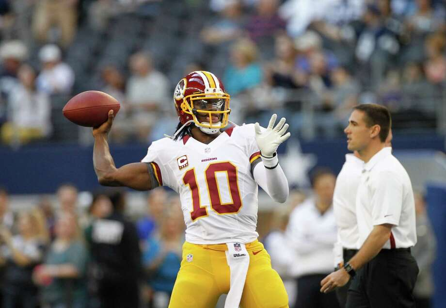 Washington Redskins quarterback Robert Griffin III (10) passes during warm ups before an NFL football game against the Dallas Cowboys Thursday, Nov. 22, 2012, in Arlington, Texas. (AP Photo/Tim Sharp) Photo: Tim Sharp, Associated Press / FR62992 AP