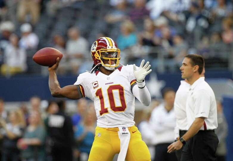 Washington Redskins quarterback Robert Griffin III (10) passes during warm ups before an NFL footbal